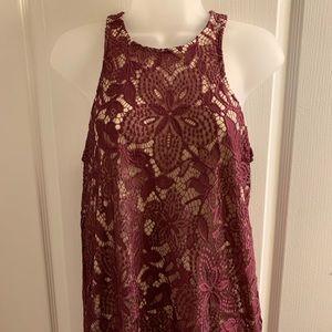 Dark maroon lace dress.